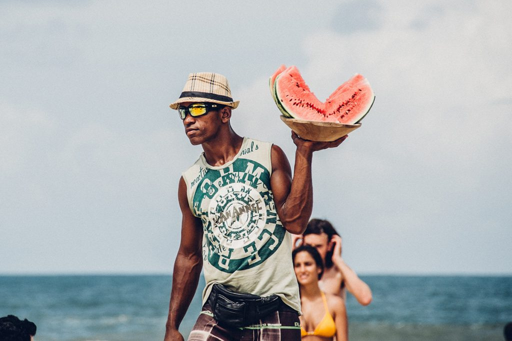 African young man selling water melon